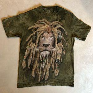 Tie-dye DJ Jahman Lion with dreads and head phones